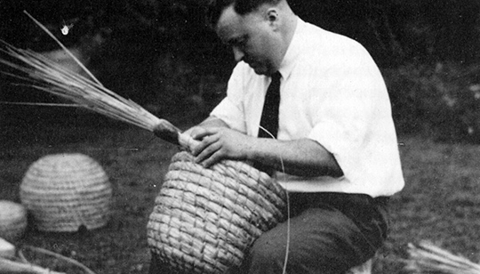 George Hawthorne at work; a finished skep, with entrance hole cut, can be seen in the background