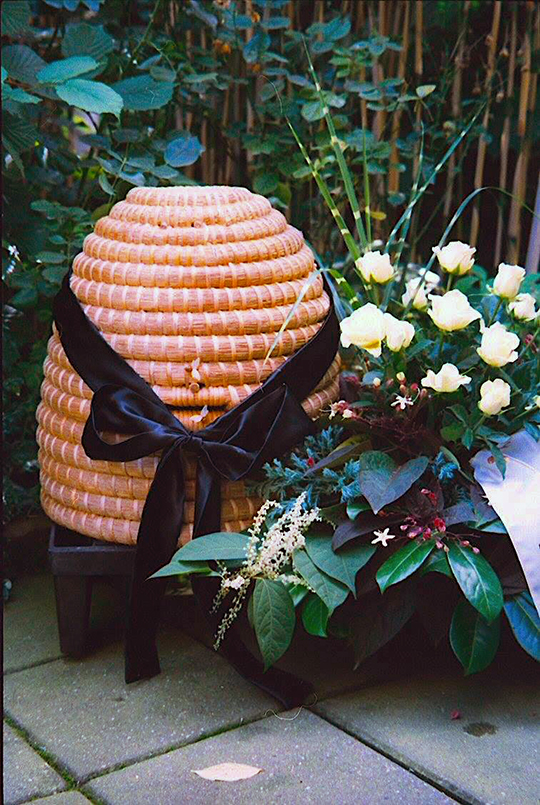 Telling the Bees - a black ribbon tied around a skep. Photo by Tinus Klosters.