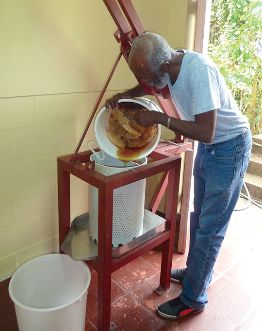 filling the press, turning the screw, the honey flows!, the remainder of the wax.